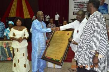 Nana Dwamena and Executive Sec (CLOSAG) presenting a citation to former HCS